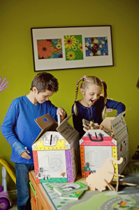 Two children play with treasure chest boxes from TWO MEN AND A TRUCK
