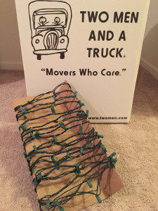 Wrap each string of lights and garland around a separate piece of cardboard