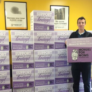 Our Quality Control Specialist, Keith, holding a Movers for Moms collection box