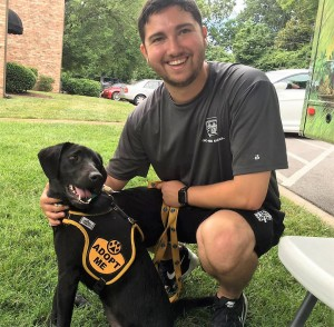 Marketer Christian with a dog from Nashville Humane Association