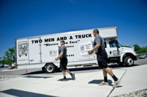 TWO MEN AND A TRUCK parking on the street